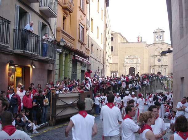 Spain's 'Running of the Bulls'  by Ian Mackenzie / CC BY